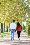 couple-walking-happy-autumn-park-35295520